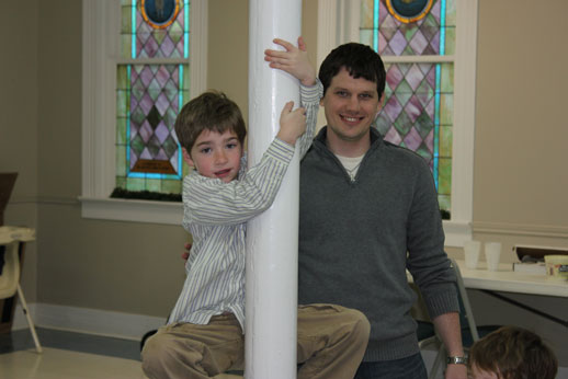 Fellowshipping with the Children: nathan teaching jordan to climb the pole