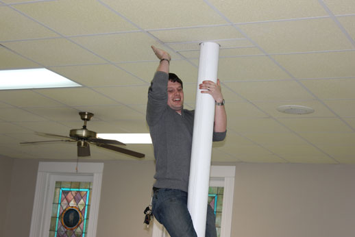 Fellowshipping with the Children: the preacher climbing the pole